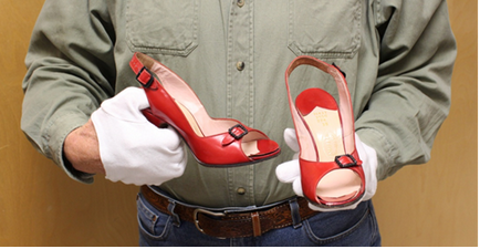 Man holding red high heels